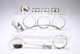 A GROUP OF SILVER AND PLATE, comprising four white-metal 'jewelled' napkin rings; a large Viners