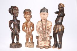 Four carved tribal figures, tallest approximately 35cm
