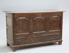 ~ AN OAK MULE CHEST, LATE 17TH/EARLY 18TH CENTURY, the moulded top above a front of three ogee