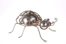 AN UNUSUAL 20TH CENTURY METAL AND GLASS MODEL OF A BEETLE, with blue glass eyes. 36cm long