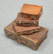 ~ FOUR PIECES OF VINTAGE LUGGAGE, including a large leather case with 'NORTH' printed to the lid;