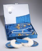 A CHINESE BOXED SET OF BLUE SILK PYJAMAS, GOWN AND SLIPPERS, worked in relief with coloured