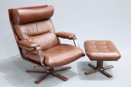 A 1970'S BROWN LEATHER AND BENTWOOD SWIVEL CHAIR AND FOOTSTOOL