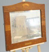 AN ARTS AND CRAFTS OAK MOTTO MIRROR, CIRCA 1900