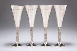 CHRISTOPHER NIGEL LAWRENCE (BORN 1936), A SET OF FOUR ELIZABETH II SILVER CHAMPAGNE FLUTES