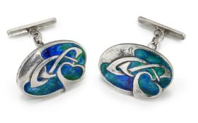 A PAIR OF ARCHIBALD KNOX (1864-1933) FOR LIBERTY & CO, CYMRIC SILVER AND ENAMEL CUFFLINKS
