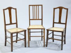 A PAIR OF EDWARDIAN INLAID MAHOGANY CANE SEATED SIDE CHAIRS, with string inlaid splat backs and