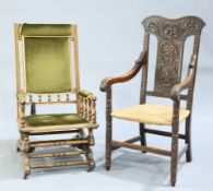 A LATE VICTORIAN CARVED OAK OPEN ARMCHAIR