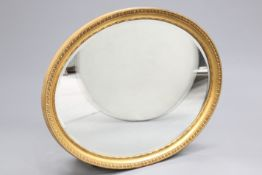 A LARGE 19TH CENTURY GILT-COMPOSITION OVAL MIRROR