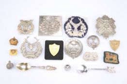 A QUANTITY OF GLENGARRY, SPORRAN AND OTHER BADGES