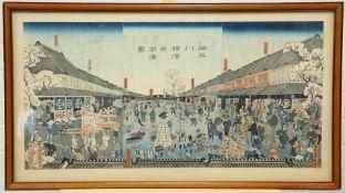 A JAPANESE WOOD-CUT, HONCHO-DORI STREET SCENE, late 19th Century, framed. 35cm by 71cm