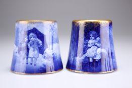 A PAIR OF ROYAL DOULTON BLUE CHILDREN SERIES VASES