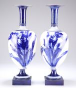 A PAIR OF ROYAL DOULTON FLOW BLUE VASES, EARLY 20TH CENTURY, the onion-shaped bodies decorated