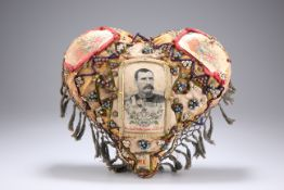 A BOER WAR PERIOD HEART-SHAPED 'FORGET ME NOT' CUSHION