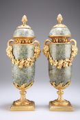 A PAIR OF CONTINENTAL GILT-METAL MOUNTED SERPENTINE VASES AND COVERS