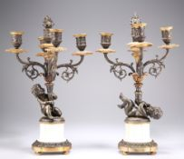 A PAIR OF FRENCH PATINATED BRONZE AND PARCEL-GILT FOUR-LIGHT CANDELABRA