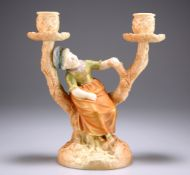 A ROYAL WORCESTER TWO-BRANCH CANDLE HOLDER