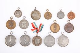 A QUANTITY OF MEDALLIONS FOR SPORTS