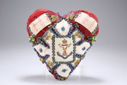 A HEART-SHAPED 'FORGET ME NOT' CUSHION