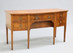 A REGENCY STYLE MAHOGANY BOWFRONTED SIDEBOARD