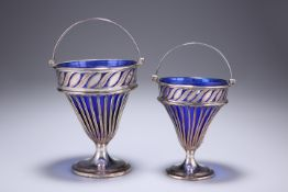 A GRADUATED PAIR OF OLD SHEFFIELD PLATED SWING-HANDLED BASKETS