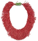 A DYED CORAL BEAD NECKLACE AND FAUX JADE PENDANT