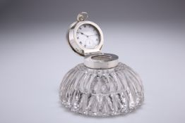 AN EDWARDIAN CUT-GLASS AND SILVER COMBINED CAPSTAN INKWELL AND WATCH STAND