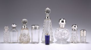A GROUP OF SIX SILVER-MOUNTED GLASS SCENT BOTTLES AND FLASKS