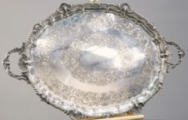 A LARGE VICTORIAN SILVER-PLATED TWO-HANDLED TRAY