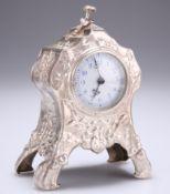 AN EDWARD VII SILVER MANTEL CLOCK