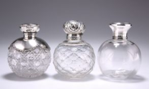 A GROUP OF THREE SILVER-MOUNTED GLASS SCENT BOTTLES