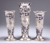 A GARNITURE OF THREE VICTORIAN SILVER VASES