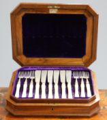 A SET OF VICTORIAN SILVER AND IVORY-HANDLED FISH KNIVES AND FORKS