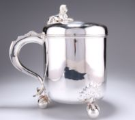 A VICTORIAN SILVER LIDDED TANKARD OF SUBSTANTIAL PROPORTIONS
