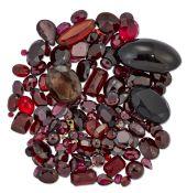 A QUANTITY OF VARI-CUT GARNETS, RED PASTE AND QUARTZ