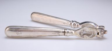 A PAIR OF GEORGE V SILVER-HANDLED NUT CRACKERS