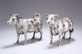 A PAIR OF SILVER MODELS OF CATTLE
