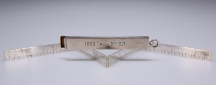 AN EDWARD VII SILVER TRAVELLING RULER IN SILVER CASE
