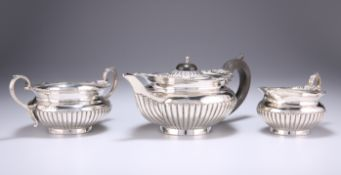 A VICTORIAN SILVER THREE-PIECE BACHELOR'S TEA SERVICE