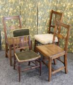 A PAIR OF EARLY 19TH CENTURY OAK COUNTRY CHAIRS