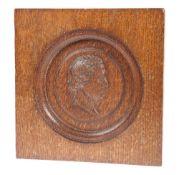 A LATE 19TH CENTURY CARVED OAK PLAQUE
