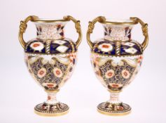 A PAIR OF LATE 19TH CENTURY DAVENPORT PORCELAIN TWIN HANDLED VASES