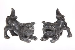 A PAIR OF CHINESE BRONZE MODELS OF FOO DOGS