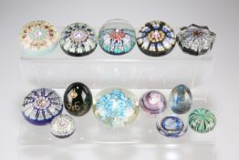A GROUP OF GLASS PAPERWEIGHTS