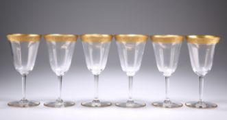 A SET OF SIX SAINT LOUIS GILDED WINE GLASSES,
