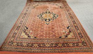 A LARGE INDIAN CARPET