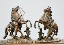 AFTER COUSTOU, A PAIR OF 19TH CENTURY BRONZE MARLY HORSES