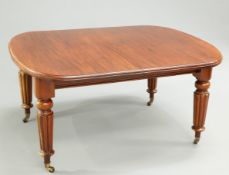 A VICTORIAN MAHOGANY WIND OUT EXTENDING DINING TABLE