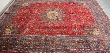 A PERSIAN RED GROUND KASHAN CARPET