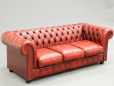 A DEEP BUTTONED RED LEATHER CHESTERFIELD SOFA